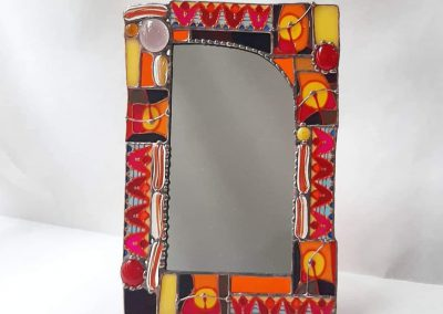 Mirror in stained glass frame